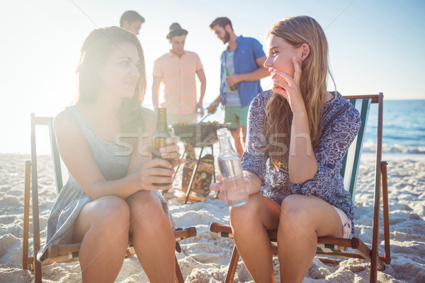Happy friends doing barbecue and drinking beer Stock photo © wavebreak_media