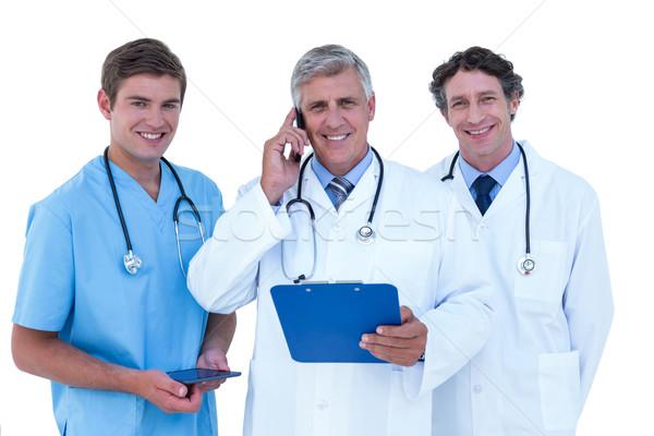 Zdjęcia stock: Lekarza · telefonu · schowek · biały · człowiek