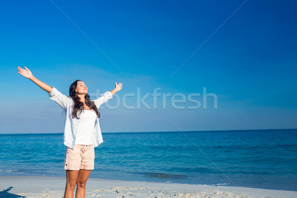 Happy woman with eyes closed at the beach Stock photo © wavebreak_media