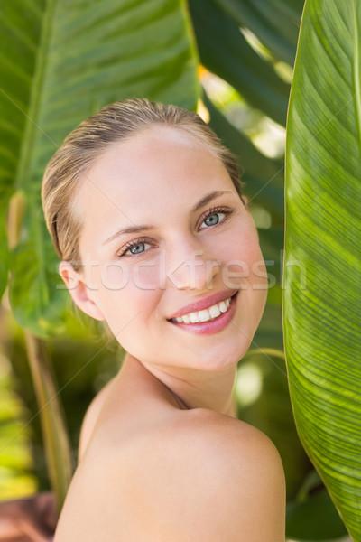 Gyönyörű szőke nő mosolyog kamera mögött levél Stock fotó © wavebreak_media