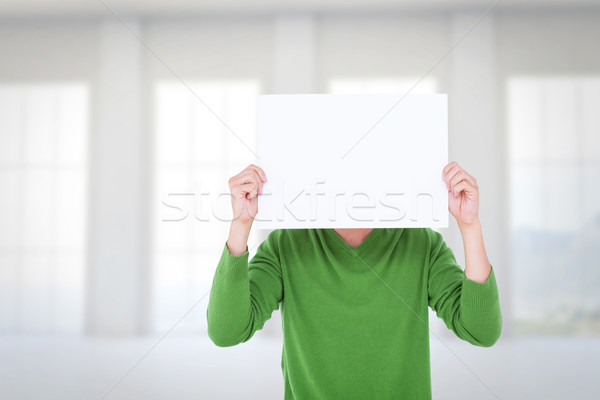 Composite image of man holding blank sign in front of face Stock photo © wavebreak_media