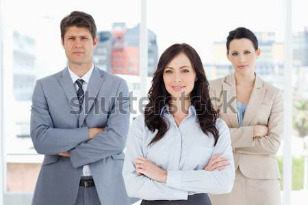 Sorridente equipe de negócios escritório olhando câmera homem Foto stock © wavebreak_media