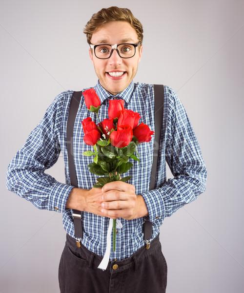 Hipszter tart köteg rózsák szürke szeretet Stock fotó © wavebreak_media
