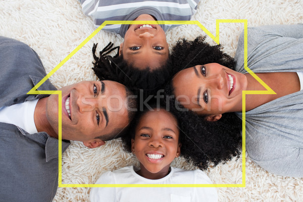 Composite image of family on floor with heads together Stock photo © wavebreak_media