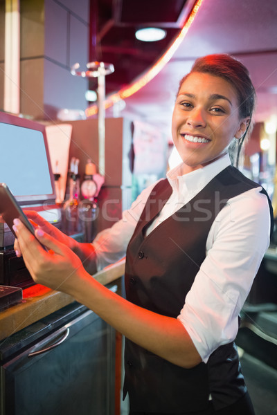 Pretty barmaid using touchscreen till  Stock photo © wavebreak_media