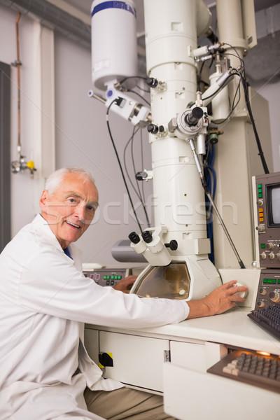 Nagy mikroszkóp számítógép egyetem férfi boldog Stock fotó © wavebreak_media