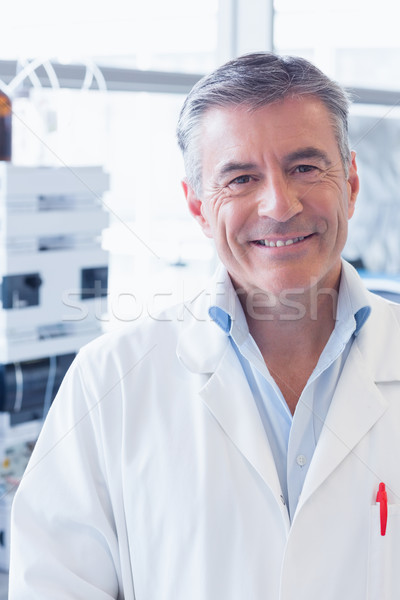 Portrait of a smiling scientist wearing lab coat Stock photo © wavebreak_media