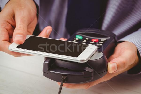Férfi okostelefon expressz illetmény fa asztal üzlet Stock fotó © wavebreak_media
