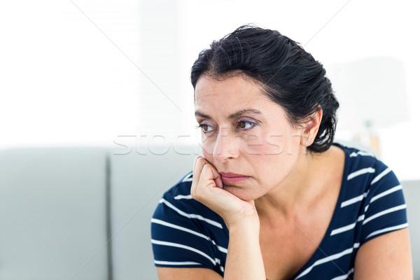 Malheureux femme séance canapé blanche triste Photo stock © wavebreak_media