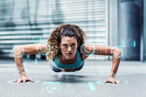 Composite image of attentive muscular woman doing pushups  Stock photo © wavebreak_media