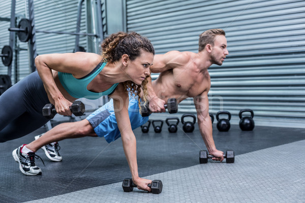Muscular couple doing plank exercise together Stock photo © wavebreak_media