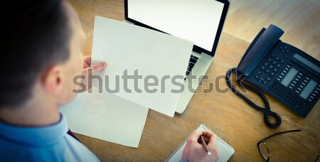 Focused businessman reading document at desk Stock photo © wavebreak_media