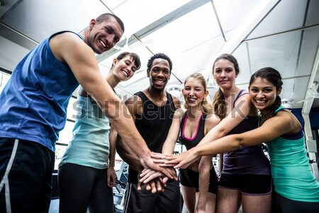 Stock photo: Fit people putting their hands together