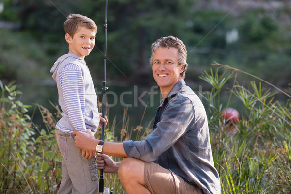 Father and son with fishing rod on field Stock photo © wavebreak_media