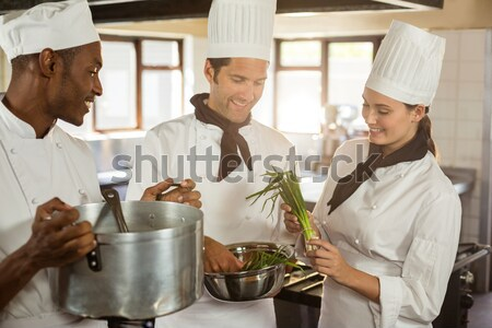 Restaurant manager with his kitchen staff Stock photo © wavebreak_media