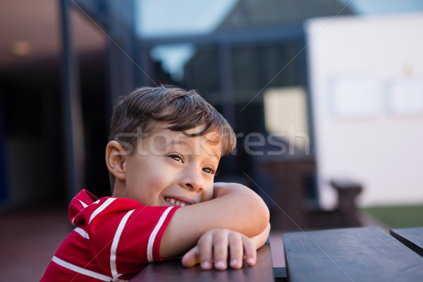 Stock photo: Close up of cheerful boy looking away