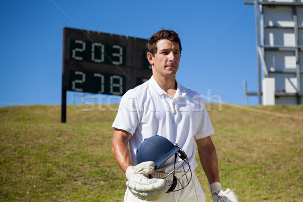 Cricket speler helm veld vastbesloten Stockfoto © wavebreak_media