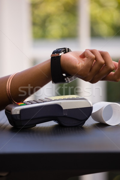 Hand of customer making payment via smart watch Stock photo © wavebreak_media