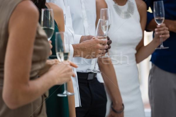 Mid section of friends holding wineglasses Stock photo © wavebreak_media