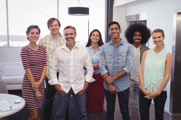 улыбаясь бизнес-команды Постоянный Creative служба портрет Сток-фото © wavebreak_media