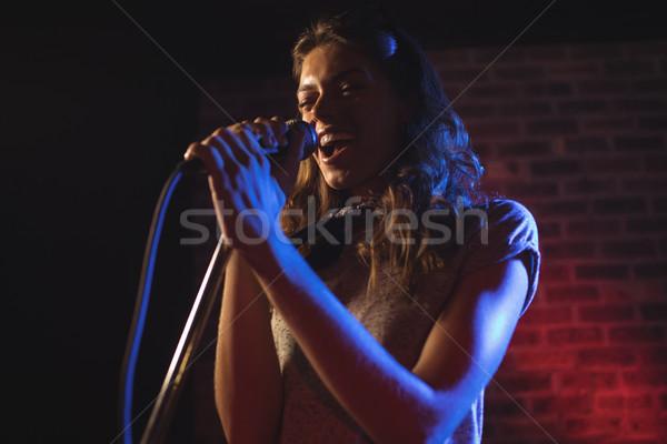 Enthusiastic female singer performing at music concert Stock photo © wavebreak_media