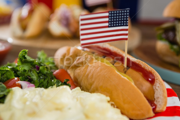 American flag and hot dogs on wooden table Stock photo © wavebreak_media