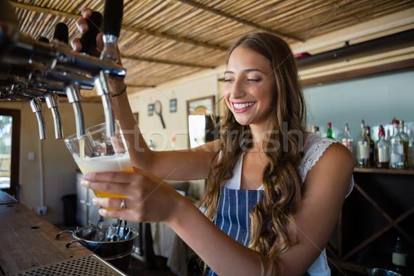 счастливым пива водопроводной стекла молодые Сток-фото © wavebreak_media