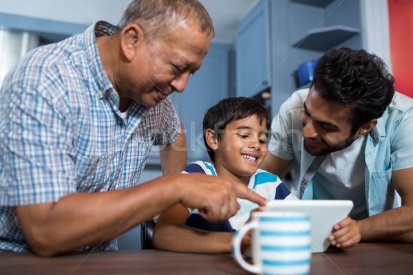 Happy family using digital table Stock photo © wavebreak_media