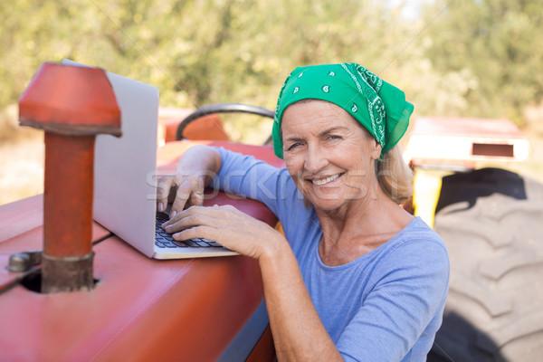 Portrait of happy woman using laptop Stock photo © wavebreak_media