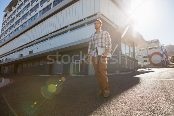 Man looking away while standing on city street Stock photo © wavebreak_media