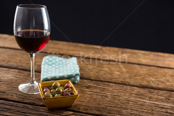 Stock photo: Close-up of marinated olives with glass of wine