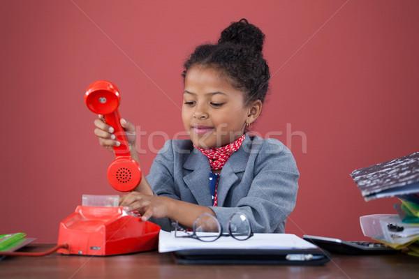 Businesswoman using land line phone Stock photo © wavebreak_media