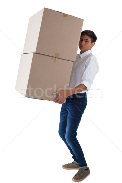 Boy carrying heavy boxes Stock photo © wavebreak_media
