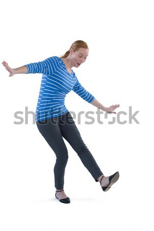 Teenage girl pushing against white background Stock photo © wavebreak_media
