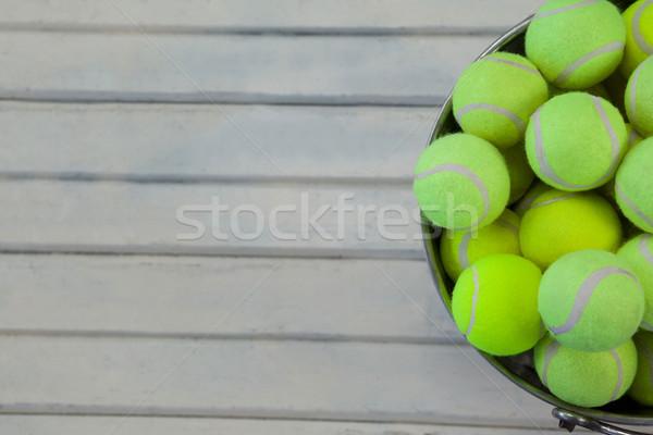 Directly above view of tennis balls in metallic bucket Stock photo © wavebreak_media