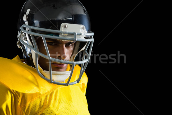 American football player with a head gear Stock photo © wavebreak_media