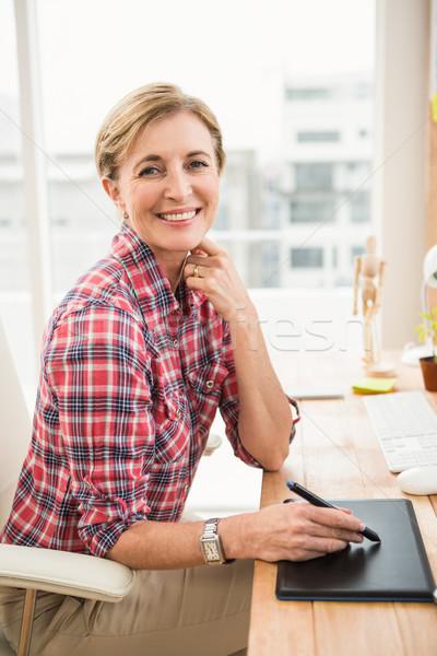Smiling casual designer working with digitizer Stock photo © wavebreak_media