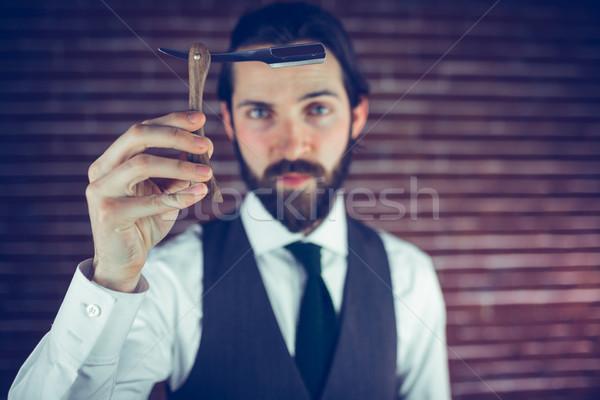 Portré komoly hipszter mutat borotva téglafal Stock fotó © wavebreak_media