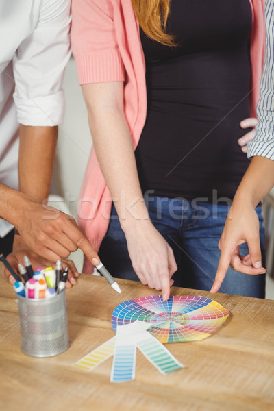 Colleagues pointing towards multi colored charts Stock photo © wavebreak_media