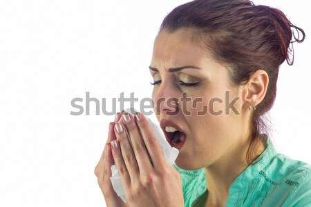 Sneezing woman holding tissue with eyes closed  Stock photo © wavebreak_media
