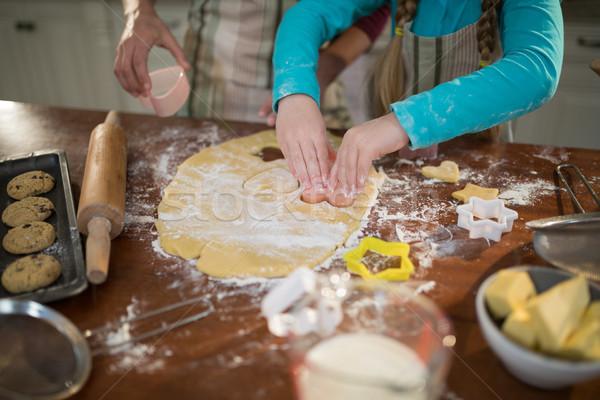 Mother and daughter preparing cookies in kitchen Stock photo © wavebreak_media