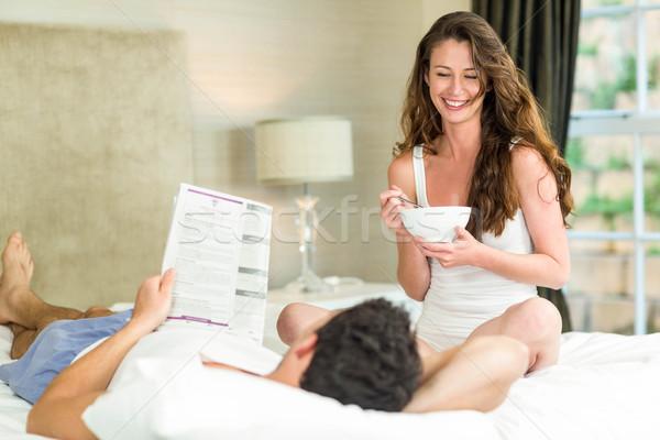 чтение газета завтрак кровать спальня Сток-фото © wavebreak_media