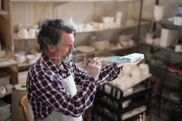 Male potter painting slab Stock photo © wavebreak_media