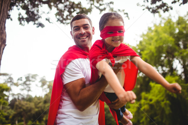 Father and daughter pretending to be a superhero  Stock photo © wavebreak_media