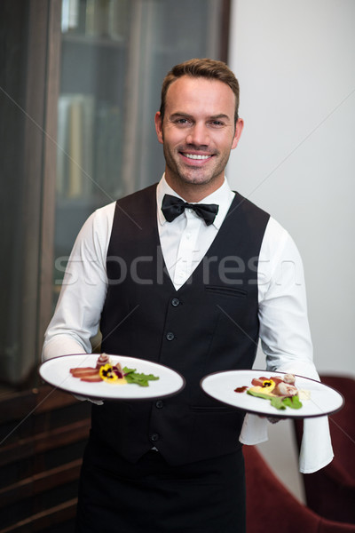 Portrait of waiter presenting meals Stock photo © wavebreak_media