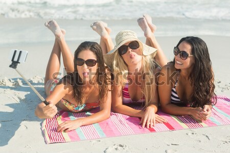 Group of friends taking selfie with selfie stick Stock photo © wavebreak_media