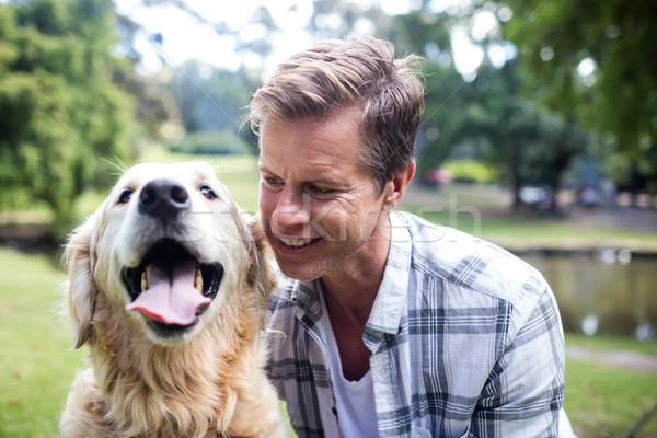 Smiling man with his pet dog Stock photo © wavebreak_media