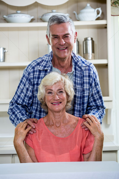 Smiling senior couple in kitchen at home Stock photo © wavebreak_media