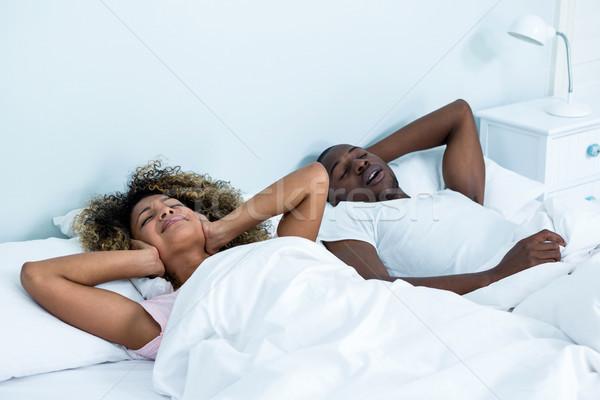 Woman ignoring while man snoring on bed Stock photo © wavebreak_media