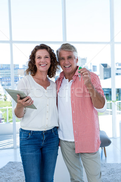 Portrait of happy couple standing at home Stock photo © wavebreak_media
